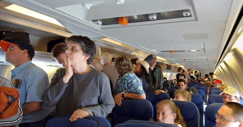 SIT DOWN: People Who Stand Up After Landing Sure They Will Exit Faster